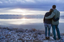 Couple Embraces As They Look O...