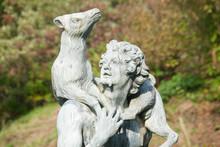 Stone Sculpture Of Man Carrying Deer