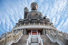 Giant Buddha Po Lin Monastery At Lantau Island In Hong Kong With Blue Sky