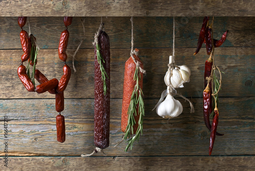 Sausages with rosemary , garlic and pepper. Canvas Print