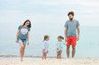 Family vacation parents and children on the sea shore summer day
