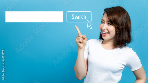 Fototapeta young woman pointing at the search bar. obraz