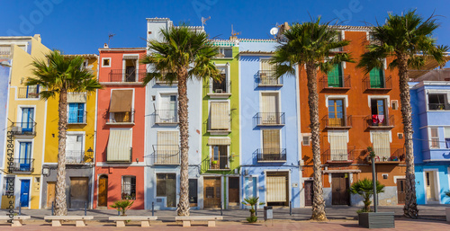 Panorama of colorful houses and palm trees in Villajoyosa