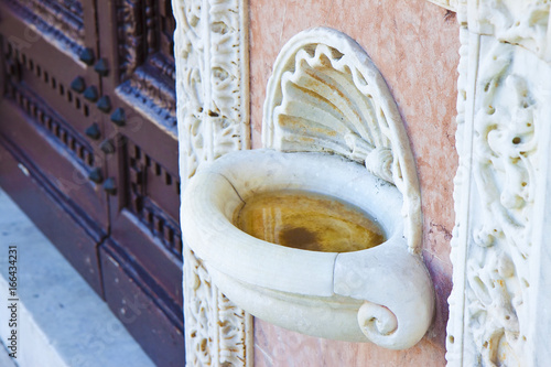 Inlaid marble holy water font in an Italian church - Buy