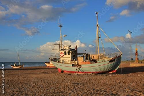 Papiers peints Scandinavie Summer day at Slettestrand, Jammerbugten. Fishing boat on the shore.