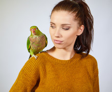 Woman Feeding Parrots. Isolate...