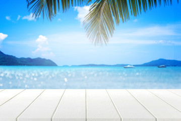 white wooden table and beautiful sea in summer.