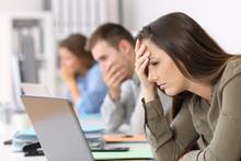 Three Worried Employees Readin...