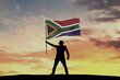 canvas print picture - Male silhouette figure waving South Africa flag. 3D Rendering