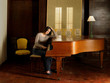 Young woman playing piano resting elbow