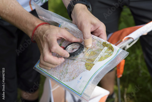 Compass and map for orienteering