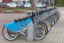 A Rental Bicycles Stand In A Row On A Parking