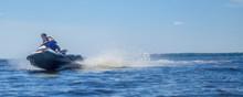 Woman Riding Jet Ski On Lake I...