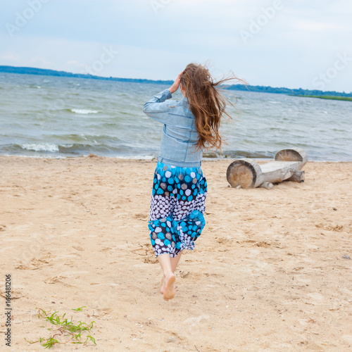 Young teen on the beach — img 3