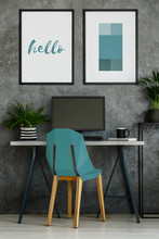 Turquoise Chair In Gray Interior