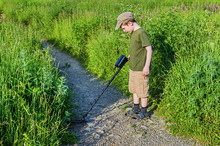 Serious Boy With A Metal Detector