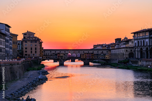 Sunset at Ponte Vecchio (Old Bridge) over the river Arno in Florence, Italy Wallpaper Mural