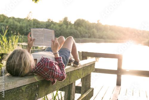 Fotografie, Obraz  girl reading a book in the sun