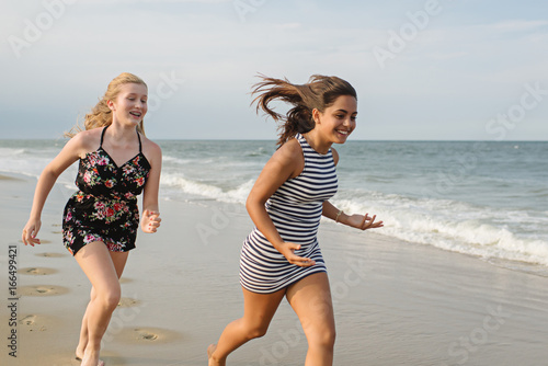 Two friends racing on the beach