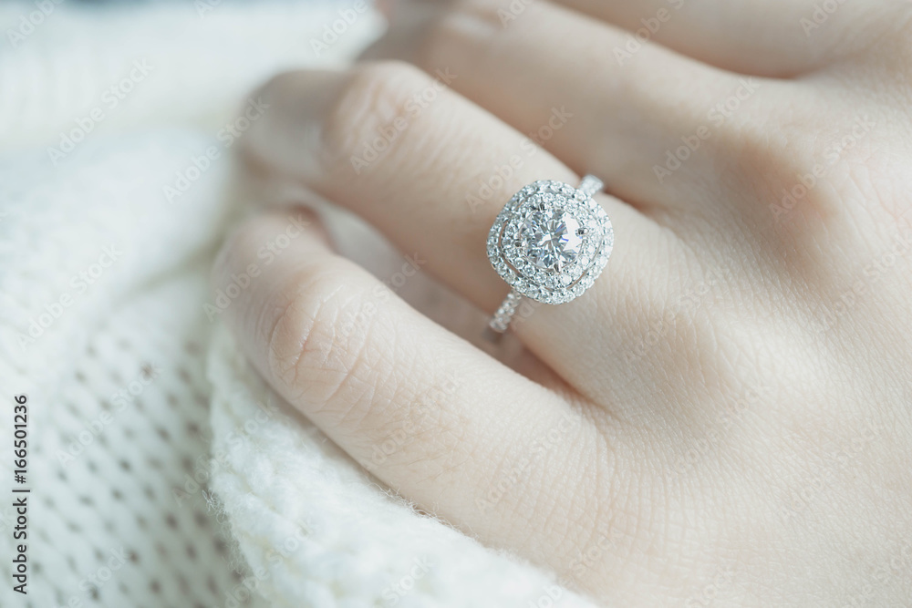Fototapety, obrazy: Close up Diamond ring on woman's finger before wedding with white scarf background.(soft and selective focus)