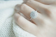 canvas print picture - Close up Diamond ring on woman's finger before wedding with white scarf background.(soft and selective focus)