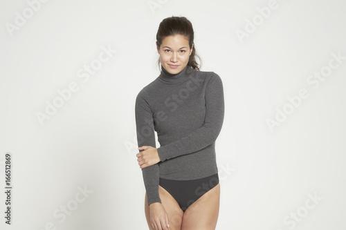 Model posing in grey long sleeve shirt.