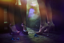 Legs Of Young Women At Nightclub