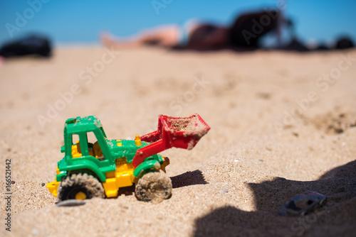 Fotografie, Obraz  Tractor toy on the sandy beach
