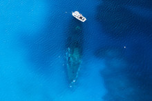 A Dive Boat Over A Large Underwater Shipwreck In Clear, Blue, Tropical Waters