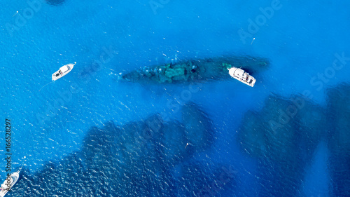 SCUBA diving boats over the wreck of the USS Kittiwake in the Cayman Islands