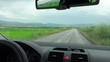 Driving a car on rural road on rainy