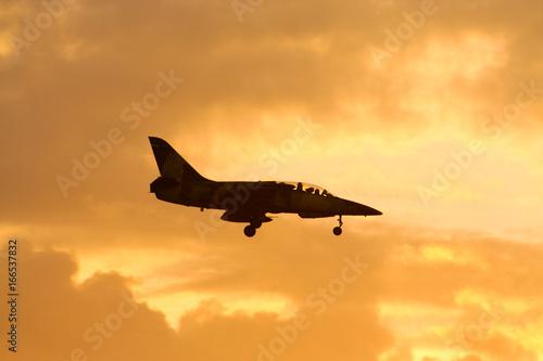 fototapeta na ścianę Aircraft Fligther Landing shot at sunset time