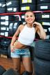 Portrait of cheerful girl in auto workshop