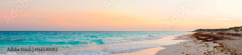 Foto auf Acrylglas See sonnenuntergang Panorama of amazing beautiful sunset on white sandy beach