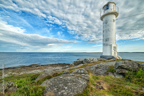 Spoed Foto op Canvas Vuurtoren Swedish lighthouse in morning light