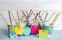 Colorful Paper Cups With Empty Labels  Striped Straws For Birthday Party.