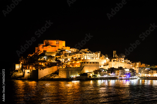Nocturnal illumination of the castle and old district of the town of Peniscola.