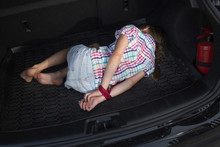 A Child With Tied Hands Lies In The Trunk