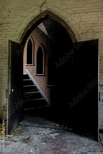 Open Doors Leading To Staircase With Wood Paneling And Arch Windows    Abandoned Church