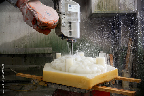 An ABB robotic arm is seen carving marble at the Henraux
