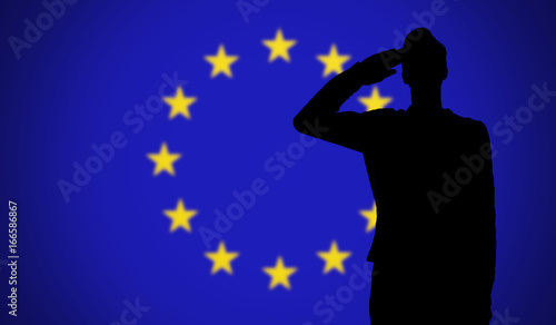 Photo  Silhouette of a soldier saluting against the european union flag