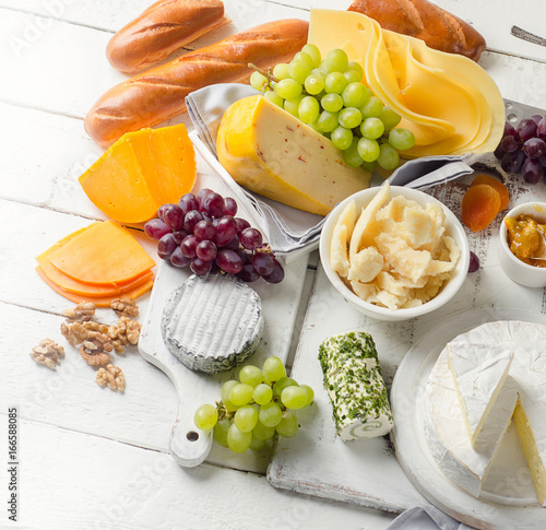 Cheese plate served with grapes Poster