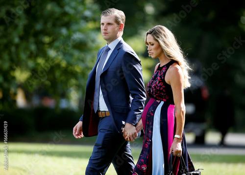 Eric Trump and his wife Lara Yunaska walk to Marine One at