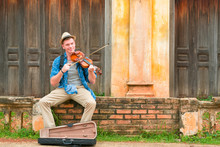Caucasian Man Playing Violin W...