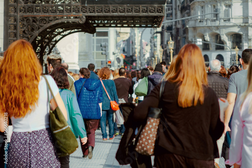 Keuken foto achterwand Buenos Aires People walking on the street seen from behind