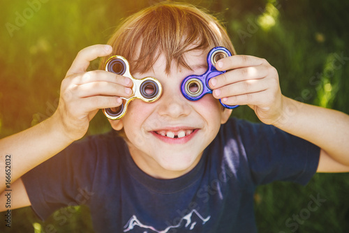Happy boy with two spinners Canvas Print