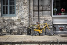Yellow Bike Leaning Against St...