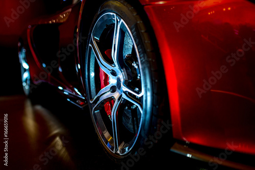 Fotografía  Close Up on beautiful modern supercar with dramatic lighting