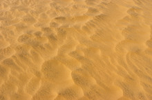 Waves Of Sand In Hot Desert - Aerial View