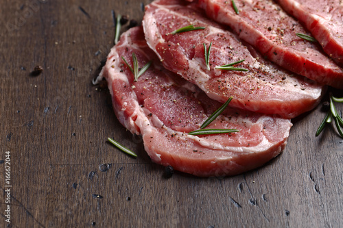 Fotografering  Pork steak with rosemary and pepper